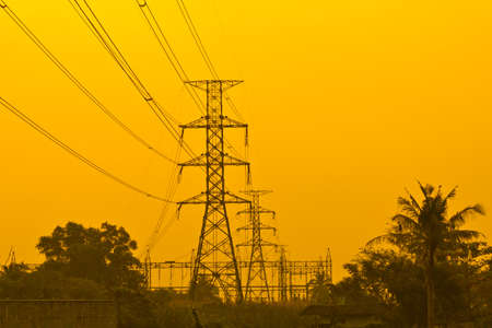 Electricity Pillars against a colorful yellow sunset  photo