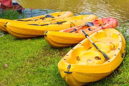 Four Empty Plastic Canoes Stock Photo