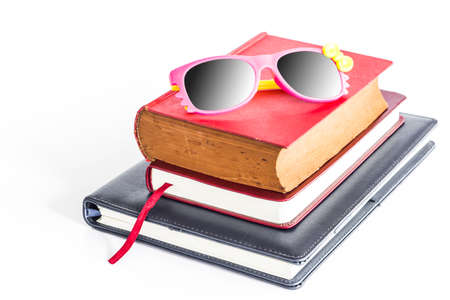 Woman s sunglasses on the books  photo
