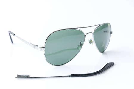 mangy: Shabby old sunglasses on white background Stock Photo
