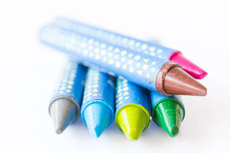 Multicolored crayons on a white background. Stock Photo