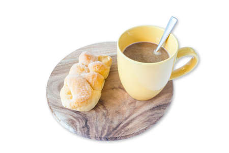 Bread on a wooden tray with a cup of coffee.