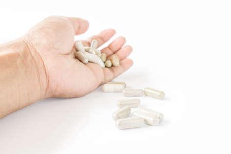 sobredosis: sobredosis y tenía unas pastillas en la mano Foto de archivo