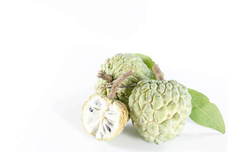 Custard apple and leaves on white background photo