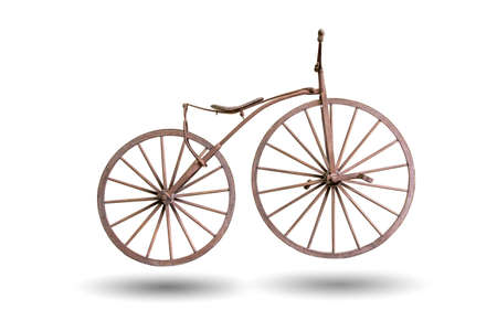 old bicycle with wooden wheels isolated with clipping path