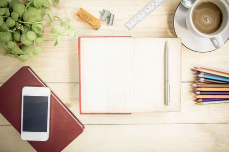 colores: Open notebook diary on wooden table with coffee, vintage style.