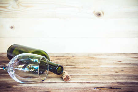 big cork: vintage cork from wine bottle and glass on the old wood floor.