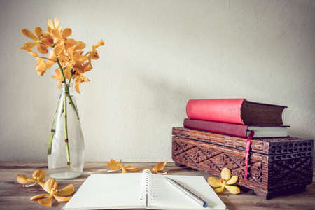 Open Books and flower, home decoration concept