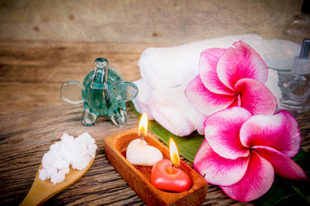wellness: Spa and wellness setting with natural bath salt, candles and towel.