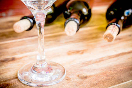 wine glasses: Red wine bottle, glass and grape shaped corks on wooden table Stock Photo