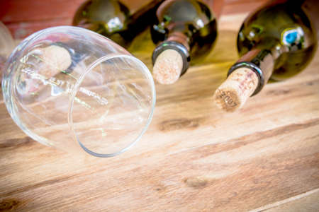 glass bottle: Red wine bottle, glass and grape shaped corks on wooden table Stock Photo