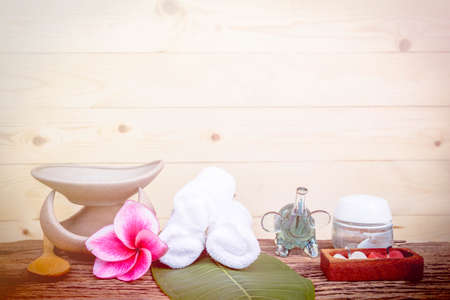 relaxation background: Spa and wellness setting with natural bath salt, candles and towel. made with color filters,blurred focus Stock Photo