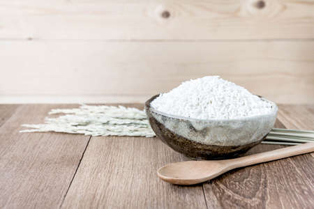 thialand: Thai jasmine rice in ceramic cup  and wooden spoon - soft focus