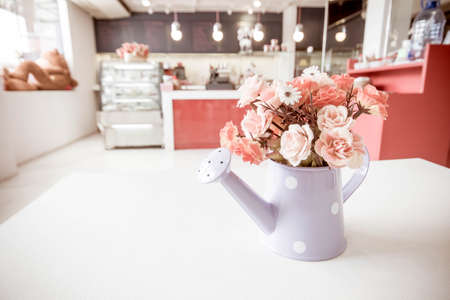 Artificial flower in vintage style coffee shop.