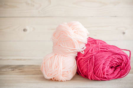 spokes: threads for knitting with spokes on wooden table Stock Photo