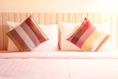 messed: bed sheets and colorful pillow messed up in the morning and color tone effect. Stock Photo