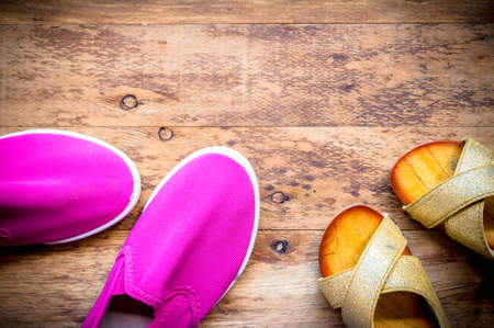 Mother and Daughter pink shoes on wooden background, Mothers Day.