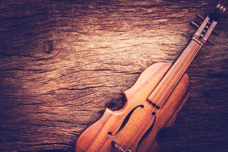 twelfth night: Violin on grunge dark wood background