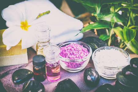 pampering: Spa accessories, Rolled towel, pampering stuff and frangipani flowers. Stock Photo