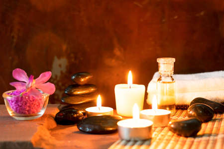 Spa still life with aromatic candles,orchid flower and towel.