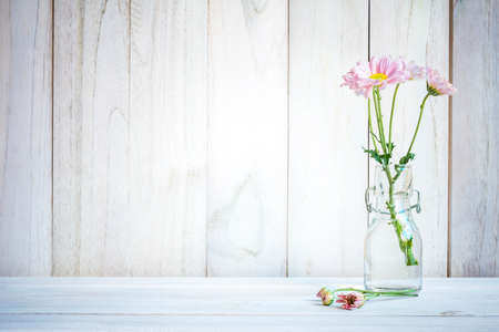 Home interior decorbouquet of pink flowers in a vase on white home interior decorbouquet of pink flowers in a vase on white wood table background mightylinksfo
