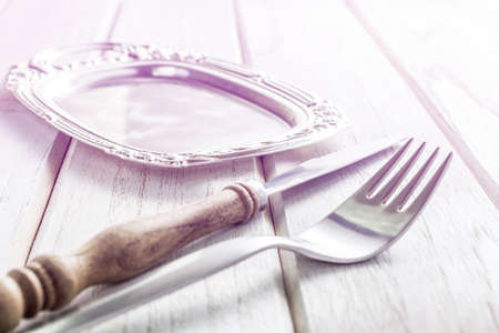 old fork and knife on white wooden table, Vintage stye.