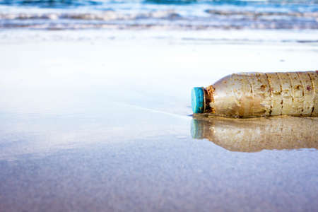 hellish: Plastic bottle is on the beach left by tourist