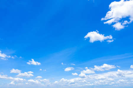 Blue sky with scattered clouds