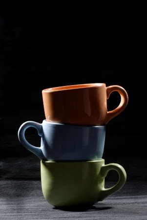 Multi-colored cups on a gray background Stock Photo - 4628523