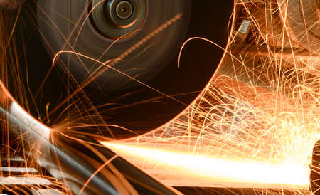 cutting metal: Industrial worker cutting and welding metal with many sharp sparks Stock Photo