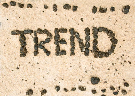 uploaded: word of the uploaded trend shit in the sand Stock Photo