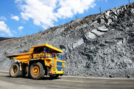 Heavy mining truck on the iron ore opencast mining quarry Stock Photo