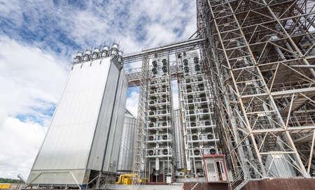 storage bin: Towers of grain drying enterprise. metal grain facility with silos