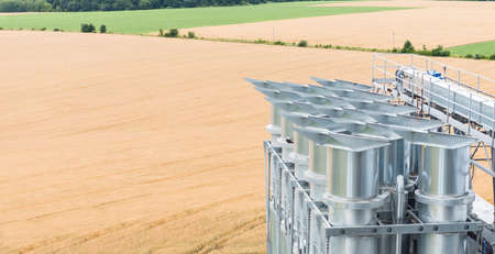 silos: Towers of grain drying enterprise. metal grain facility with silos