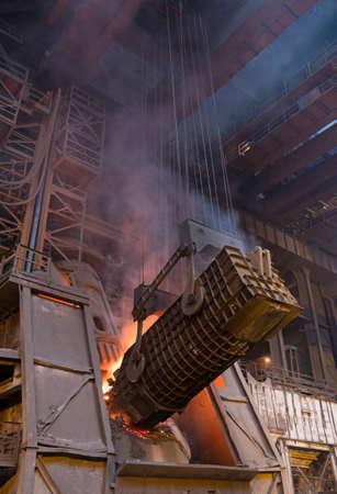 smelting plant: pouring cast iron into the converting furnace to produce steel