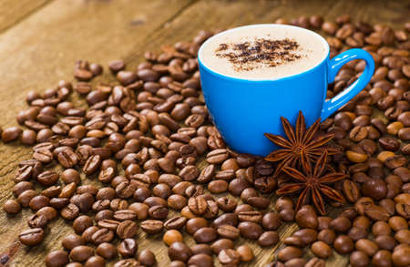 jamoke: Coffee and coffee beans on wood background Stock Photo