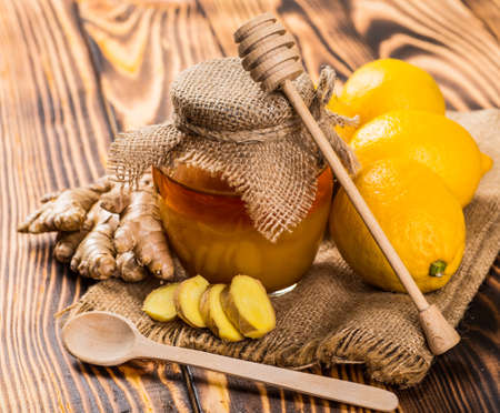 Honey with lemon and nuts. Stock Photo
