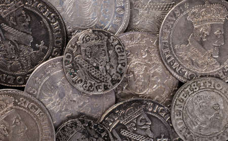 taller: trove of ancient medieval coins silver background