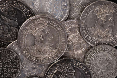 thaler: trove of ancient medieval coins silver background