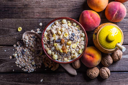 rolled oats: rolled oats in bowl and muesli ingredients