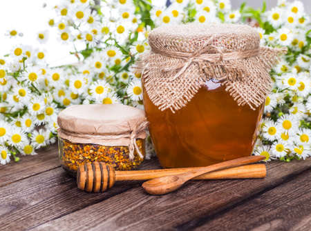 propolis: Still life with honey, honeycomb, pollen and propolis Stock Photo