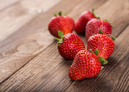 eating utensils: Ripe red strawberries on wooden table Stock Photo