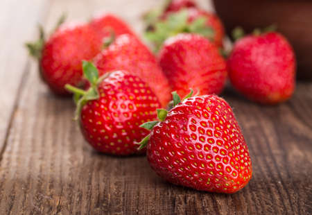Ripe red strawberries on wooden table Stock Photo