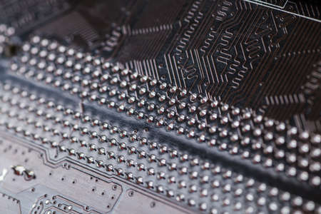 computer terminals: Macro closeup of a computer PCB  using brown and black colors with silver soldered terminals Stock Photo
