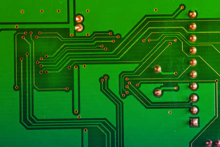 megabyte: Close up of a printed green computer circuit board