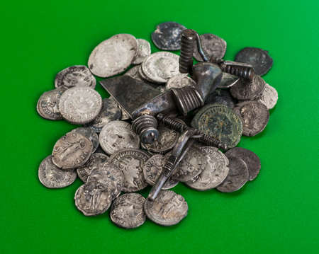 treasure trove: Antique treasure trove of Roman coins and jewelry Stock Photo