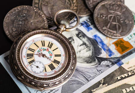 Ancient  money pocket watch background.Concept  antiques