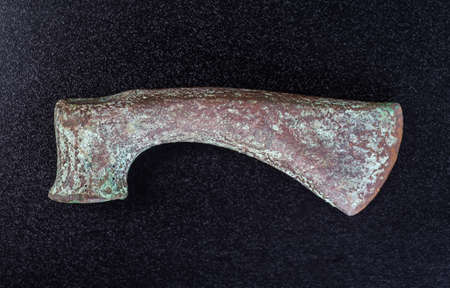 past civilization: Prehistoric bronze ax, the ancients, isolated on black background
