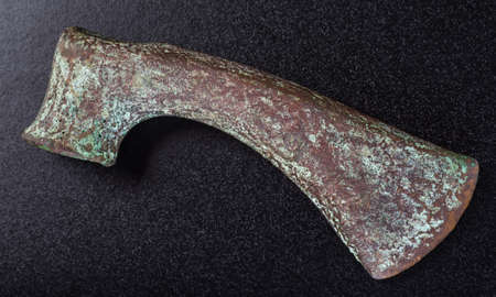 past civilizations: Prehistoric bronze ax, the ancients, isolated on black background