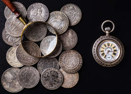 money in pocket: Ancient  money pocket watch background.Concept  antiques